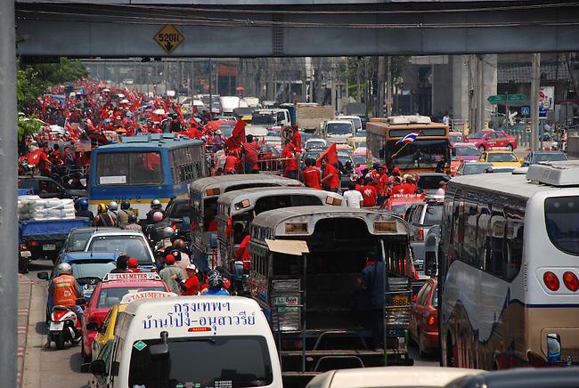 BANGKOK MARCH 20: Red Shirt protestors parade down Petchburi Road during an anti-government rally on March 20, 2010, Bangkok, Thailand.