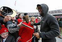 Ohio State Buckeyes quarterback Braxton Miller signs autographs during the celebration for winning the national championship at Ohio Stadium on Jan. 24, 2015. (Adam Cairns / The Columbus Dispatch)