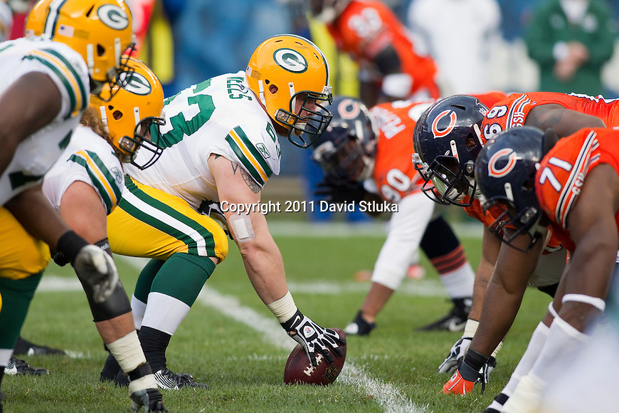 Green Bay Packers offensive lineman/center Scott Wells (63) ancors the offensive line during a week 3 NFL football game against the Chicago Bears on September 25, 2011 in Chicago. The Packers won 27-17. (AP Photo/David Stluka)