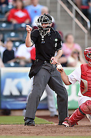 Home plate umpire Brett Terry makes a call during a game between the Frisco Rough Riders and Springfield Cardinals on June 1, 2014 at Hammons Field in Springfield, Missouri.  Springfield defeated Frisco 3-2.  (Mike Janes/Four Seam Images)