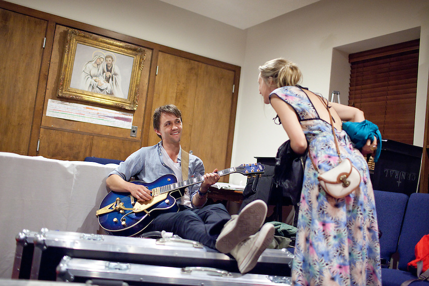Sondre Lerche spends a few moments with his wife Mona Fastvold Lerche before going on stage at Central Presbytarian Church in Austin, Texas during the 2011 SXSW Music Festival.