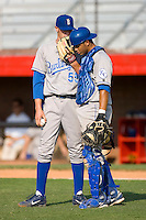 Keaton Hayenga #55 and Fernando Cruz #16 of the Burlington Royals have a conversation on the mound at Howard Johnson Stadium June 27, 2009 in Johnson City, Tennessee. (Photo by Brian Westerholt / Four Seam Images)