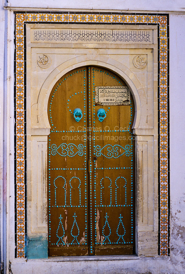 "Ceramics, Nabeul, Tunisia.  Tile Frame Around Door.  Tiles are of the ""Lion's Paw"" Design."