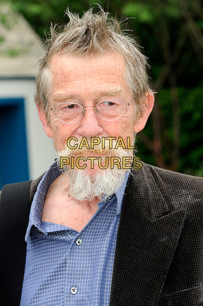 John Hurt.The Chelsea Flower Show 2012, London, England..May 21st, 2012.headshot portrait black jacket blue shirt glasses goatee facia hair .CAP/CJ.©Chris Joseph/Capital Pictures.