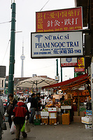 Toronto (ON) CANADA,  April 26 , 2008-..People walking and shopping  on Bathurst near  Dundas street in Chinatown,.CN Tower in Background....