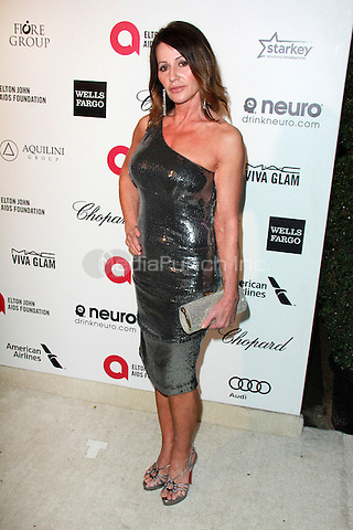WEST HOLLYWOOD, CA - FEBRUARY 22: Nadia Comenici at the 2015 Elton John AIDS Foundation Oscar Party in West Hollywood, California on February 22, 2015. Credit: David Edwards/DailyCeleb/MediaPunch