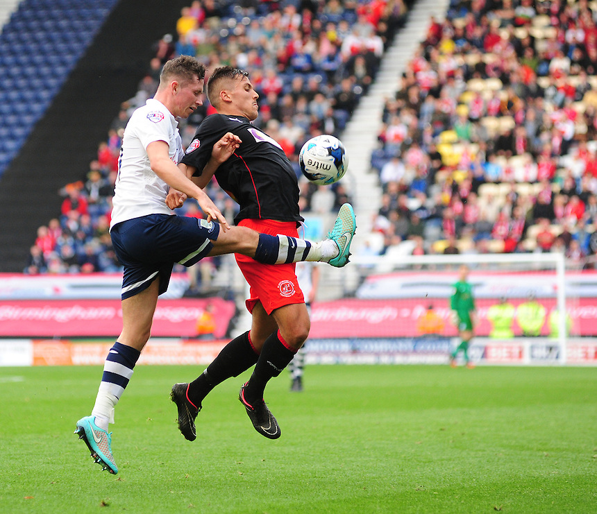 Fleetwood Town's Antoni Sarcevic shields the ball from Preston North End's Alan Browne<br /> <br /> Photographer Chris Vaughan/CameraSport<br /> <br /> Football - The Football League Sky Bet League One - Preston North End v Fleetwood Town - Saturday 25th October 2014 - Deepdale - Preston<br /> <br /> &copy; CameraSport - 43 Linden Ave. Countesthorpe. Leicester. England. LE8 5PG - Tel: +44 (0) 116 277 4147 - admin@camerasport.com - www.camerasport.com