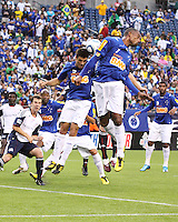 Cruzeiro midfielder Robert and Cruzeiro midfielder Fabricio leap to head the ball away from goal on a corner kick.  Brazil's Cruzeiro beat the New England Revolution, 3-0 in a friendly match at Gillette Stadium on June 13, 2010