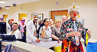 The real life Dr. Patch Adams takes a group of doctors and nurses (Dr. Jeff Joseph, Kim Steves, Maria Valencia, Kelli McDaniel, Gabi Sine, and Jeff Gay) in his huge underwear into a patients room to cheer up patients on the emergency floor at Fauquier Hospital on Monday.