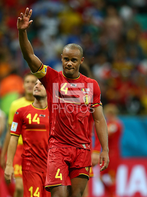 Vincent Kompany of Belgium salutes the fans as he celebrates victory