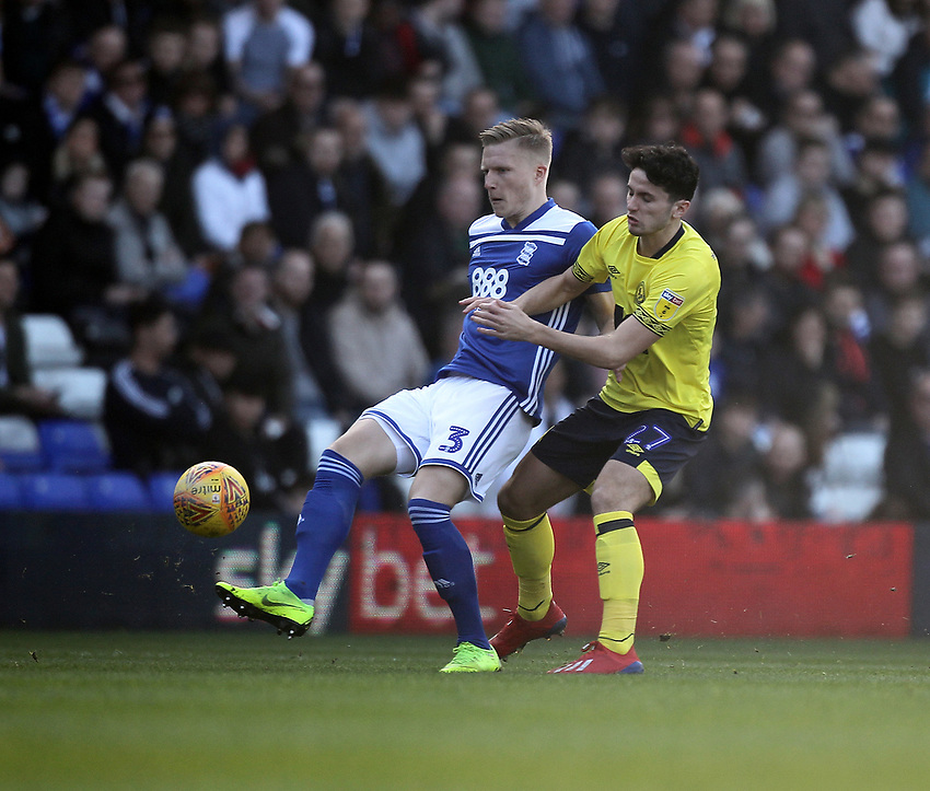 Blackburn Rovers Lewis Travis battles with  Birmingham City's Kristian Pedersen <br /> <br /> Photographer Mick Walker/CameraSport<br /> <br /> The EFL Sky Bet Championship - Birmingham City v Blackburn Rovers - Saturday 23rd February 2019 - St Andrew's - Birmingham<br /> <br /> World Copyright © 2019 CameraSport. All rights reserved. 43 Linden Ave. Countesthorpe. Leicester. England. LE8 5PG - Tel: +44 (0) 116 277 4147 - admin@camerasport.com - www.camerasport.com