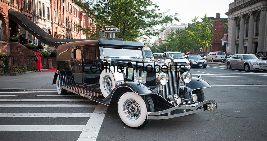 "Isaiah Owens, the owner of Owens Funeral Home, in Harlem in New York driving his 1924 Rolls-Royce hearse, in a procession, on Friday, June 21, 2013, to the Apollo Theater for a showing of Christine Turner's documentary film ""Homegoings"".  The film features Owens and his funeral home as it studies African-American traditions of death. Owens, who moved to New York in the 1960's, opened the funeral home and with just word of mouth and little advertising has become the paramount funeral home in Harlem, due to his care and understanding.  (© Richard B. Levine)"