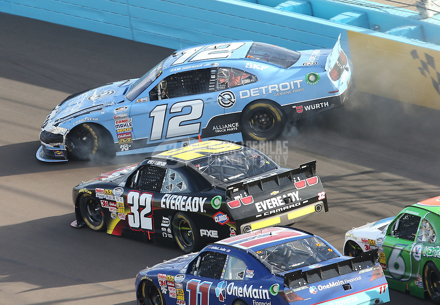 Mar. 2, 2013; Avondale, AZ, USA; NASCAR Nationwide Series driver Sam Hornish Jr (12) spins in front of Kyle Larson (32) during the Dollar General 200 at Phoenix International Raceway. Mandatory Credit: Mark J. Rebilas-