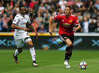(L-R) Jordan Ayew of Swansea City chases Nemanja Matic of Manchester United during the English Premier League soccer match between Swansea City and Manchester United at Liberty Stadium, Swansea, Wales, UK. Saturday 18 August 2017
