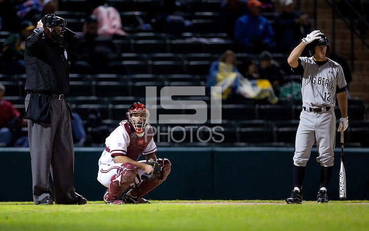STANFORD, CA - March 25, 2011: Trevor Penny of Stanford baseball looks to the dugout after replacing Zach Jones at catcher during Stanford's game against Long Beach State at Sunken Diamond. Stanford lost 6-3.