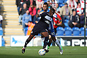 Lucas Akins of Stevenage tangles with Craig Eastmond of Colchester. Colchester United v Stevenage - npower League 1 - Weston Homes Community Stadium, Colchester - 13th October, 2012. © Kevin Coleman 2012