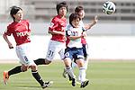 (L to R) <br /> Hikaru Naomoto (Reds), <br /> Aya Miyama (Belle), <br /> MAY 4, 2014 - Football /Soccer : <br /> Plenus Nadeshiko League 2014 <br /> between Urawa Reds Ladies 1-3 Okayama Yunogo Belle <br /> at Saitama Urawa Komaba Stadium, Saitama, Japan. <br /> (Photo by AFLO SPORT) [1205]