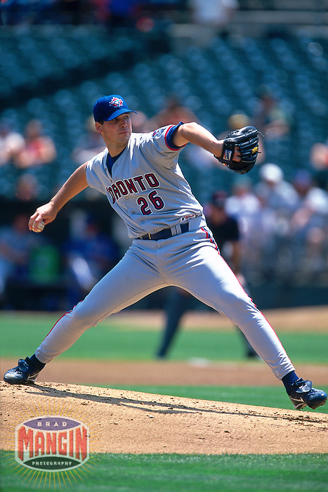 OAKLAND, CA - Chris Carpenter of the Toronto Blue Jays pitches during a game against the Oakland Athletics at the Oakland Coliseum in Oakland, California on August 2, 2000. Photo by Brad Mangin