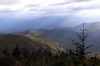 Stock photo: Sun rays fall filtered from clouds on The great smoky mountains  hills in autumn colors as seen from the foothills of the Clingmans Dome.
