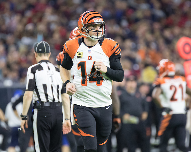 Cincinnati Bengals quarterback Andy Dalton (14) takes the field for the start of a possession during the second half of an NFL football game between the Houston Texans and the Cincinnati Bengals at NRG Stadium in Houston, Texas.