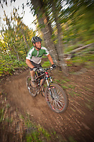 Riding the flowing bermed banked turns of The Flow trail in Copper Harbor Michigan.