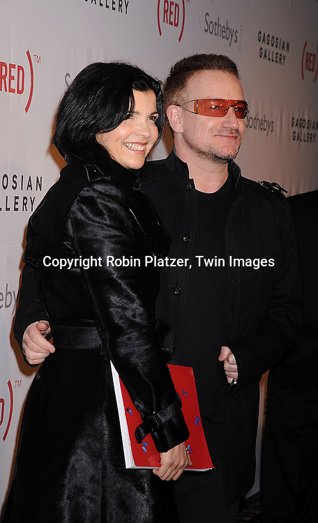 Ali Hewson and husband Bono.at The (RED) Auction at Sotheby's on February 14, 2008 in New York City. The event is designed to raise money for the treatment of HIV/AIDS in Africa. .Robin Platzer, Twin Images..212-935-0770