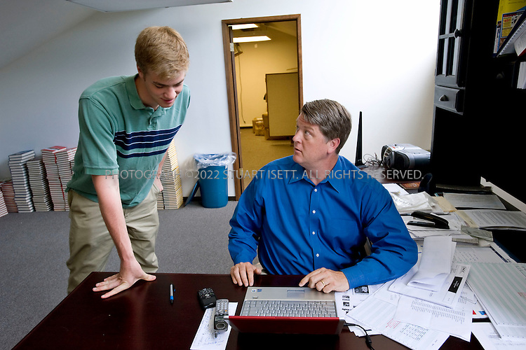 6/17/2008--Tacoma, WA, USA..Floyd Brown (right), conservative political activist, in his office in Tacoma, WA with his son, Patrick Brown, 20, who runs exposeobama.com's Facebook page. Floyd Brown is best known for the 'Willie Horton' television ad that derailed Michael Dukakis' presidential run in 1988. He has recently started a new website, exposeobama.com..Brown is active in the Republican Party and was a delegate to both the 2000 and 1996 National conventions. In 1996 he served on the Republican National Convention Platform Committee. He has been an advisor and consultant to the presidential campaigns of George H.W. Bush, Bob Dole and Steve Forbes for President campaigns. He was Midwest Regional Director of the Dole for President campaign in 1988, managing campaigns in Iowa, Minnesota, South Dakota and Nebraska..©2008 Stuart Isett. All rights reserved.