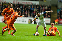 Thursday 28 November  2013  Pictured: Leon Britton makes his way through the valencia defence<br /> Re:UEFA Europa League, Swansea City FC vs Valencia CF  at the Liberty Staduim Swansea
