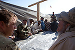 Mcc0027461 . Daily Telegraph..Major Richard Todd (left) at a Shura talking with local elders in the town of Naqilebad Kulay to assess the mood of the local inhabitants and discuss the renovation of a school which was closed and wrecked by the Taliban...Helmand 31 November 2010