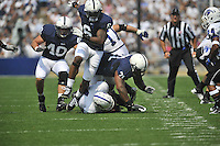 03 September 2011:  Penn State's Glenn Carson (40), Gerald Hodges (6), and Devon Still (71) converge on Indiana State QB Ronnie Fouch (4). The Penn State Nittany Lions defeated the Indiana State Sycamores 41-7 at Beaver Stadium in State College, PA..