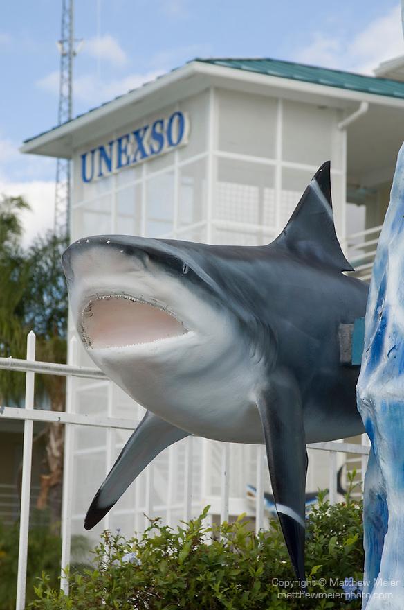 Grand Bahama Island, The Bahamas; dolpin and shark statue at the marina entrance to UNEXSO