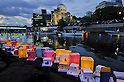 August 6, 2012, Hiroshima, Japan - Colorful paper lanterns carrying wishes for peace are released onto the Motoyasu River that runs by the Atomic Dome, background, in Hiroshima on Monday, August 6, 2012. Japan observed the 67th anniversary of the atomic bombing over this western Japanese city during World War II. (Photo by AFLO) QUB -mis-