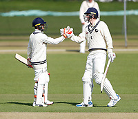 Heino Kuhn (L) is congratulated on his unbeaten century for Kent by Zak Crawley during the friendly game between Kent CCC and Surrey at the St Lawrence Ground, Canterbury, on Friday Apr 6, 2018
