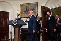 "United States President President J. Donald Trump arrives before making an announcement on the introduction of the Reforming American Immigration for a Strong Economy (RAISE) Act with US Senator Tom Cotton (Republican of Arkansas) and US Senator David Perdue (Republican of Georgia) in the Roosevelt Room at the White House in Washington, D.C., U.S., on Wednesday, August 2, 2017. The act aims to overhaul U.S. immigration by moving towards a ""merit-based"" system. Photo Credit: Zach Gibson/CNP/AdMedia"