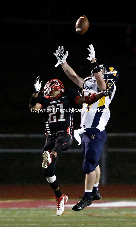 Southbury, CT- 19 September 2014-091914CM08-  Pomperaug's Jake Harwell (21) breaks up a pass intended for Weston's Peter Lummis during their SWC matchup in Southbury on Friday.    Christopher Massa Republican-American