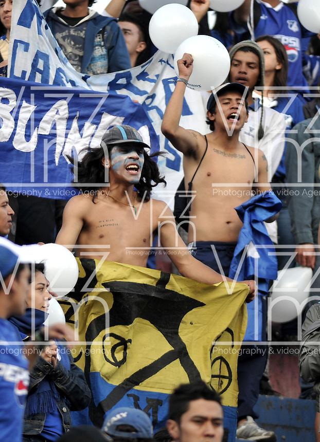 PASTO - COLOMBIA -24-03-2013: Hinchas de Millonarios, animan a su equipo , durante  partido por la Liga de Postobon I en el estadio La Libertad en la ciudad de Pasto, marzo 24 de 2013. (Foto: VizzorImage / Luis Ramírez / Staff).  Fans of Millonarios, cheers for their team during a match for the Postobon I League at La Libertad stadium in Pasto city, on March 24, 2013, (Photo: VizzorImage / Luis Ramirez / Staff)