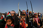 Palestinian bedouin girls wear traditional dress and hold swords during a rally marking the 41st anniversary of Land Day, in Deir el-Balah, Central Gaza Strip, on March 31, 2017.  Land Day marks the killing of six Arab Israelis during 1976 demonstrations against Israeli confiscations of Arab land. Photo by Ashraf Amra