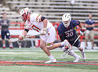 College Park, MD - May 13, 2018: Maryland Terrapins Austin Henningsen (17) wins the face off during the NCAA first round game between Robert Morris and Maryland at  Capital One Field at Maryland Stadium in College Park, MD.  (Photo by Elliott Brown/Media Images International)