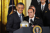 United States President Barack Obama jokes with Landon Donovan as he welcome the Stanley Cup champion Los Angeles Kings and the Major League Soccer champion LA Galaxy to the White House to honor their 2012 championship seasons in a ceremony in the East Room of the White House March 26, 2013 in Washington, DC. .Credit: Olivier Douliery / Pool via CNP