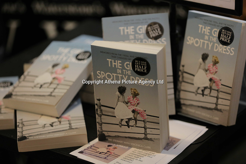 COPY BY TOM BEDFORD<br />Pictured: Copies of the book written by Pat Stewart, at Waterstone's in Blackpool.<br />Re: A pin-up girl from the 1950s has returned to the spot where she accidentally flashed her knickers and won the nation's hearts.<br />Pat Stewart was a teenage dancer when she and a pal were persuaded to pose for a picture on Blackpool seafront.<br />As the camera clicked a gust of wind lifted her skirt to give just a glimpse of forbidden flesh.<br />Pat became known as the girl in the spotty dress and it helped kick-off her showbusiness career.<br />And 65 years later Pat posed on the same spot after returning to Blackpool for the first time since the saucy snap was taken.£150 MINIMUM FOR NEWSPAPER USE PLEASE