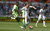 Kelechi Iheanacho of Manchester City and Stephen Kingsley of Swansea City in action during the Barclays Premier League match between Swansea City and Manchester City played at The Liberty Stadium, Swansea on 15th May 2016