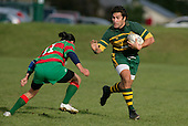 G. Leger prepares to fend off T. Kiel. Counties Manukau Premier Club Rugby, Pukekohe v Waiuku  played at the Colin Lawrie field, on the 3rd of 2006.Pukekohe won 36 - 14
