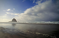 "Giant Megalith, """"Haystack Rock. World's 3rd largest natural monolith. Popular tourist resort on Oregon's Pacific Coast. Ocean, beach, sand, surf, reflection, coastline. Cannon Beach Oregon USA."