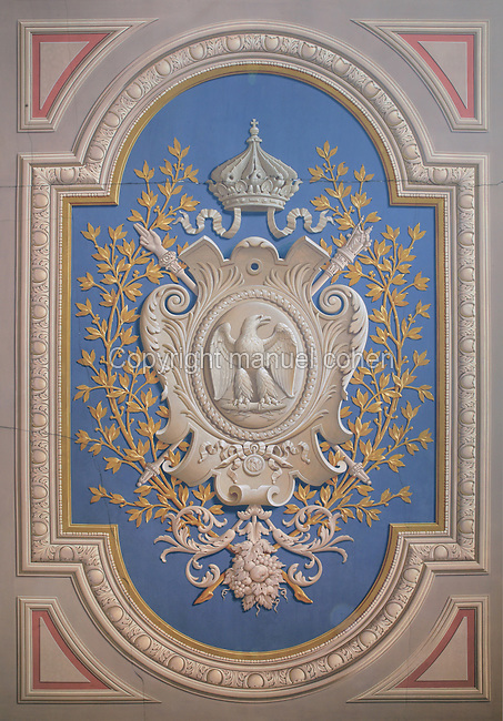 Ceiling fresco from the Galerie des Fastes, depicting the Napoleonic coat of arms, at the Chateau de Fontainebleau, France. The Palace of Fontainebleau is one of the largest French royal palaces and was begun in the early 16th century for Francois I. It was listed as a UNESCO World Heritage Site in 1981. Picture by Manuel Cohen