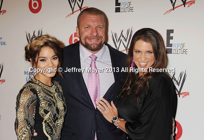 "BEVERLY HILLS, CA- AUGUST 15: (L-R) Actress Vanessa Hudgens, professional wreslter Paul ""Triple H"" Levesque, and WWE Executive Vice President of Creative, Stephanie McMahon attend WWE & E! Entertainment's 'SuperStars For Hope' at the Beverly Hills Hotel on August 15, 2013 in Beverly Hills, California."