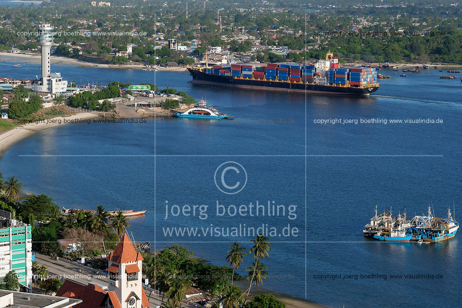 TANZANIA Daressalaam, bay and seaport, Pacific International Lines PIL container ship sailing to indian ocean, in front protestant Azania Front cathedral, built during german colonial time, Kigamboni Ferry Terminal