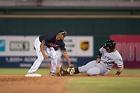 AZL Indians 1 second baseman Richard Palacios (13) applies the tag to Harvin Mendoza (20) during an Arizona League game against the AZL White Sox at Goodyear Ballpark on June 20, 2018 in Goodyear, Arizona. AZL Indians 1 defeated AZL White Sox 8-7. (Zachary Lucy/Four Seam Images)