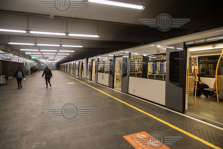 An unusual quiet underground platform by the central train station, Jernbanetorget.  Oslo is quiet as Covid-19 reached the Norwegian capital.  The Coronavirus promoted authorities to restrict business and travel in the country. <br /> <br /> ©Fredrik Naumann/felix Features
