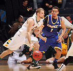 SIOUX FALLS, SD - MARCH 10:  Taylor Braun #24 from North Dakota State University drives against Nelson Kirksey #1 from UMKC in the second half of their semifinal game Sunday evening at the 2013 Summit League Basketball Tournament in Sioux Falls. SD. (Photo by Dave Eggen/Inertia)