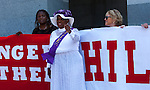 """A small crowd gathered at the State Capitol on Thursday, August 18, 2016 in Sacramento, California to celebrate the 96th anniversary of the ratification of the 19th Amendment to the United States Constitution granting women the right to vote.  Kate Van Buren, Mistress of Ceremony, introduced speakers, Gina Mulligan, author of """"Remember The Ladies"""", Angelique Ashby, Sacramento City Council, Nancy Compton, League of Women Voters, Katie McCleary, of 916 Ink and Rachel Michellin of CA Women Lead.  Singer-song writer Virginia Ayers Dawson began the event by singing the National Anthem and as a closing ceremony the group unfurled the banner for the Unity Banner For Hillary Project for a group photograph.  Diana Madoshi, of Rocklin, wore her Suffragette costume to the event.   Photo/Victoria Sheridan 2016"""